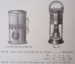 Glue pot with heating shroud, intended for use with an alcohol burner (but could be used with a Kerosene burner), and glue pot originally set up for use with a kerosene burner. Alcohol burns cleaner than kerosene, hence the open arrangement for ventilation.